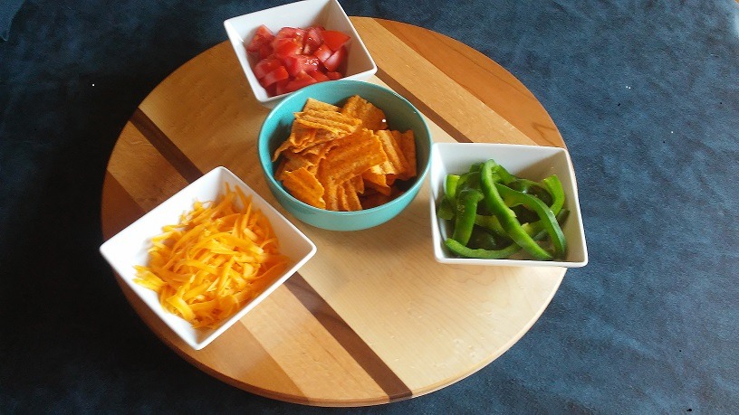 lazy susan holding chips cheese and vegies